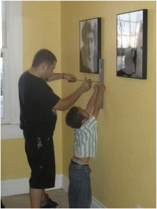 man & boy hanging picture