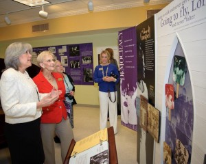 Carol Harsh, Museum on Main Street, gives Georgia First Lady Sandra Deal a tour of the New Harmonies exhibit.