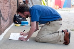man writing sign