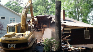 A Decatur home being demolished in 2012. The house, which had been bought by a developer, had closets full of clothes and a full attic of belongings from the family that last lived there. Photo by the author.
