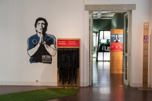 The exhibit's leading image, Argentina's legendary Diego Maradona in his classic praying pose, introduced a striking thematic juxtaposition. Photo Credit: Caro Bonink/Amsterdam Museum