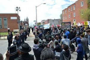 Protest at the Baltimore Police Department Western District building at N. Mount St. and Riggs Ave. Photo credit: Veggies, Wikimedia Commons.