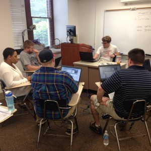Students in Dr. Black's seminar learning collections management software in May 2015.  Image courtesy of Ron Faraday, Greater Pittston Historical Society.
