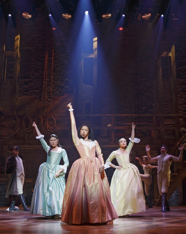 As Alexander Hamilton's wife, Eliza Schuyler Hamilton, actress Phillipa Soo (left) dances alongside Schuyler's sisters Angelica (Renée Elise Goldsberry, center) and Peggy ( Jasmine Cephas Jones, right). Photo credit: Joan Marcus.