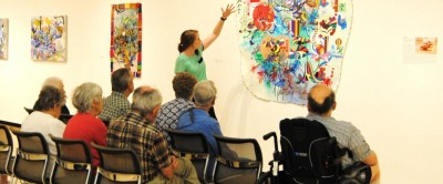Participants in an Arts Fusion tour discuss a work from the Taubman Museum of Art's permanent collection. Photo credit: Courtesy of the Taubman Museum of Art.