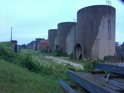 Twenty cylindrical concrete sand bins are the most visible element inside the McMillan Sand Filtration Site. Photo credit: David Rotenstein.