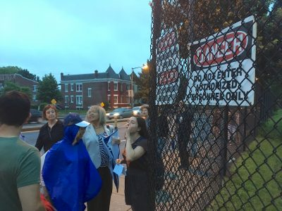 Activists gather outside McMillan Sand Filtration Site fence before entering at dusk on July 4, 2016. Photo credit: David Rotenstein.