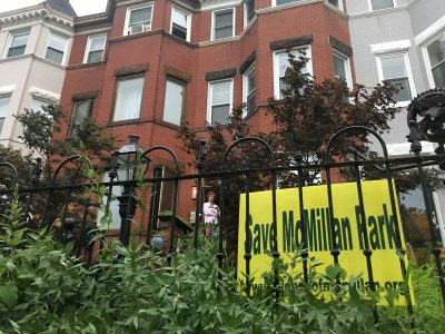 The Save McMillan party was held inside a historic Bloomingdale rowhouse. It is one of many in the neighborhood with the distinctive yellow signs produced by the preservation advocates. Photo credit: David Rotenstein.