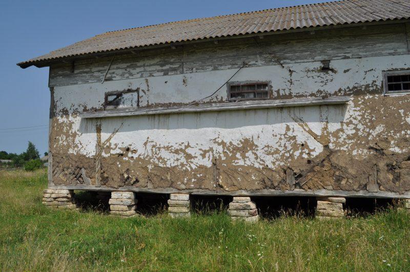 Barn resting on pillars of headstones. Photo credit: Jonathan Schaffer