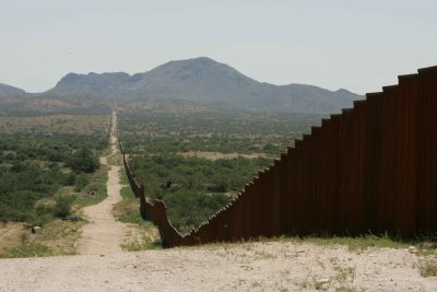 Border fence. Photo credit: Steve Hillebrand, U.S. Fish and Wildlife Service, Wikimedia Commons