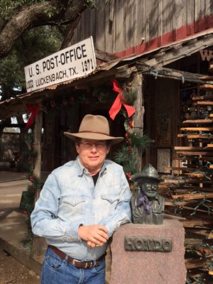 At the historic Luckenbach, Texas store and dance hall with bust of Texas legend Honda Crouch. Photo credit: Patrick Cox.