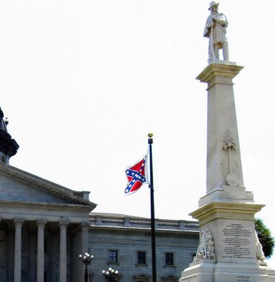 Confederate Battle Flag Flying at South Carolina State Capitol, Columbia, SC. Photo by Ken Lund, https://www.flickr.com/photos/kenlund/5811088422, CC BY-SA 2.0.