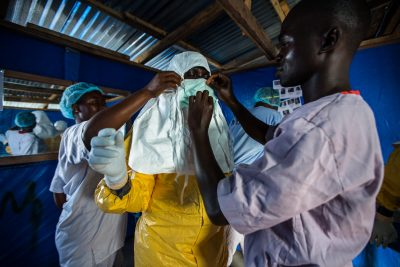 Felicia, a 29-year-old Liberian nurse, prepares to go inside the Ebola patient ward to draw blood from confirmed patients in Bong County, Liberia on October 9, 2014. Photograph by Morgana Wingard, courtesy USAID
