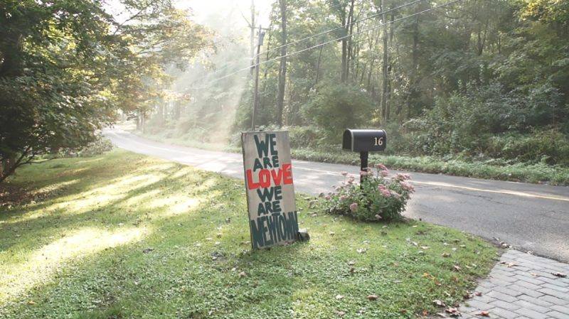 A sign made by a resident of Newtown, Connecticut, following the Sandy Hook Elementary School shooting in 2012. Source: The Story of the Stuff.