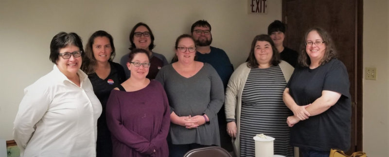This photograph includes nine collections service project volunteers: Front Row-Tracey Tate, Sara Frankel, Camille Breeze, Leah Rafaela Cereillo, Deborah G. Rossi. Back Row-Diane Lee, Mell Scalzi, Daniel Neff, Morgan Blei Carbone