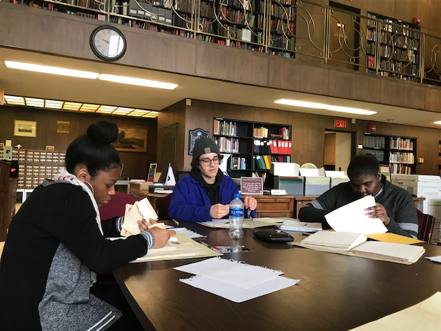 Students conducting research at the Detroit Public Library. Used by permission of Terees Western.