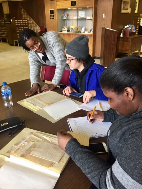 Students conducting research and taking digital photos, with Professor Tiya Miles, at the Detroit Public Library. Used by permission of Cynthia Long, Detroit Study Club Member.