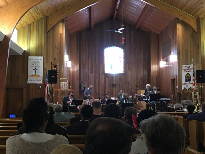 This is a photograph of a band playing in a church.
