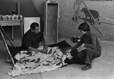 Cheyenne elder Richard Tallbull and Denver Museum of Nature & Science curator Joyce Herold sitting on the museum floor while developing a Cheyenne diorama in the early 1970s. Photo credit: Denver Museum of Nature & Science