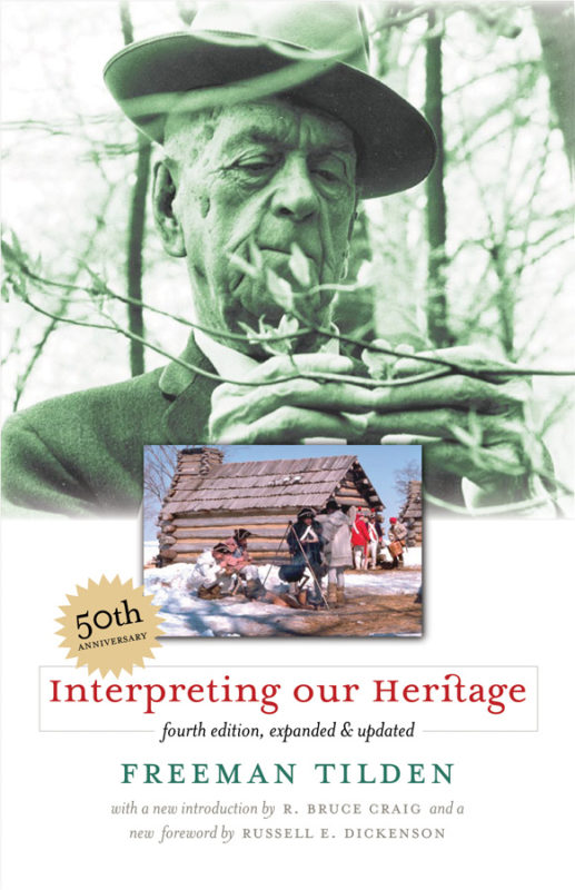 This is an image of the 50th-anniversary cover of Tilden's book Interpreting our Heritage. It includes a green-toned photograph of Tilden outside, a full-color photograph of Revolutionary war-era soldiers outside near log buildings and a fire in the winter, and the book's title and author information.